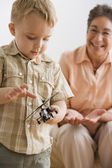 Boy playing with toy helicopter — Stock Photo
