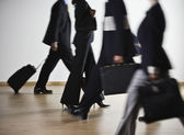 Blurred motion shot of multi-ethnic businesspeople — Stock Photo
