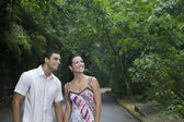 Hispanic couple on road in woods — Stock Photo