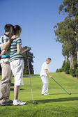 Senior Asian woman playing golf — Stock Photo