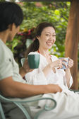 Asian couple drinking coffee — Stock Photo