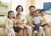 Multi-ethnic family on sofa — Stock Photo