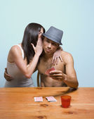 Multi-ethnic couple playing strip poker — Stock Photo