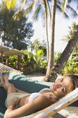 Asian woman laying in hammock — Stock Photo