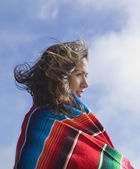 Hispanic woman wrapped in blanket — Stock Photo