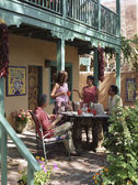 Multi-ethnic family on patio — Stock Photo