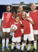 Multi-ethnic children in soccer uniforms — Stock Photo