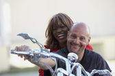 Multi-ethnic couple on motorcycle — Stock Photo