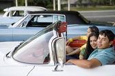 Multi-ethnic couple in convertible — Stock Photo