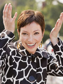 Hispanic woman with hands up in air — Stock Photo