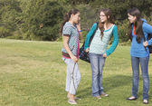 Hispanic teenaged girls in park — Stock Photo