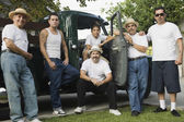 Multi-generational Hispanic male family members in front of truck — Стоковое фото