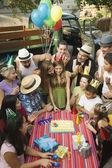 Hispanic girl celebrating birthday with family — Stock Photo