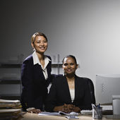Multi-ethnic businesswomen behind desk — Stock Photo