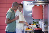 African American couple hugging in kitchen — Stock Photo
