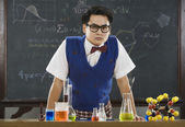 Nerdy Asian male student in science class — Stock Photo