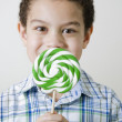 Mixed race boy with oversized lollipop — 图库照片