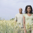 African couple in remote field — Foto Stock