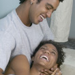 African couple smiling at each other — Stock Photo
