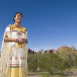 Native American woman in traditional clothing — Stock Photo
