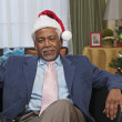 Bored African man in santa hat — Stock Photo