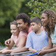 Mixed race family fishing — Stock Photo