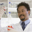 African scientist performing analysis in laboratory — Stock Photo