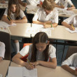 Multi-ethnic elementary students in class — Stock Photo