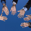 Business is hands outstretched in circle — Stock Photo