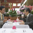 Hispanic businessmen talking at restaurant — Stock Photo
