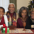 African couple with grandchildren celebrating Kwanzaa — Stock Photo