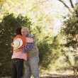 Hispanic couple hugging in park — Stock Photo