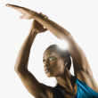 Woman stretching arms overhead — Stock Photo