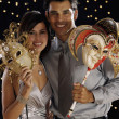 Hispanic couple dressed for night out with ornate masks — 图库照片
