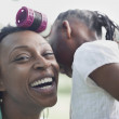 African girl telling mother secrets — Stock Photo