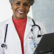 African female doctor with medical chart — Foto Stock