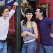 Hispanic men flirting with woman — Foto Stock