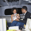 African couple toasting with champagne in limousine — Stock Photo