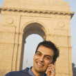 Indian man talking on cell phone near the India Gate — Stock Photo