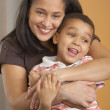 Dominican mother hugging son — Stock Photo