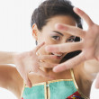 Mixed race woman sticking hand out — Stok fotoğraf