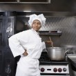 Mixed Race female chef preparing food — Stock Photo