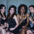 Stock Photo: Women drinking cocktails in nightclub