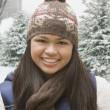 Stock Photo: Hispanic girl in stocking cap and scarf outdoors