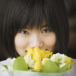 Asian woman holding flower bouquet — Stock Photo