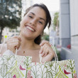 Brazilian teenager holding shopping bags — Stock Photo
