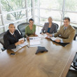 Businesspeople having meeting in conference room — Stockfoto
