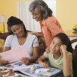 African family making scrapbook together — Stock Photo