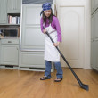 Woman sweeping kitchen floor — Stock Photo
