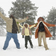 African family playing in the snow — Stock Photo #23331522